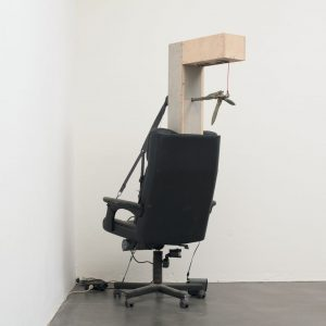 Andreas Fischer: The One Who Counts to Three, 2010. Installation with office chair, light bulb, wood, anchor, sound, motor and microprocessor